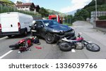 Small photo of Frontal car accident with two motorbikes and car. Massive motorcycles crash collision hit by car following a risky road overtaking. Firefighter performs accident reconstruction of an multiple crash.
