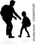 silhouettes of running men.   Shutterstock .eps vector #1336049189