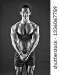 man muscular athlete stand...   Shutterstock . vector #1336067789