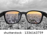 Looking Through Glasses To City ...