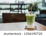 iced matcha green tea latte. | Shutterstock . vector #1336190720