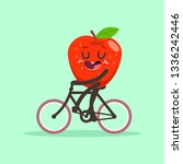cute apple rides a bike. vector ... | Shutterstock .eps vector #1336242446
