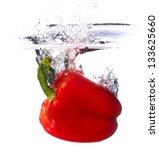 Fresh Red Paprika Falling Into...