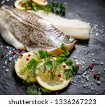 fresh raw cod fillet with... | Shutterstock . vector #1336267223