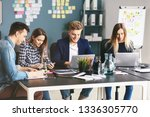 young it specialists working in ... | Shutterstock . vector #1336305770