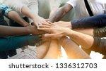 diverse team joining their hands | Shutterstock . vector #1336312703