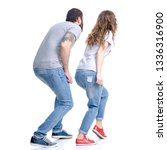 Small photo of Woman and man in jeans sneaks sneak up on white background isolation