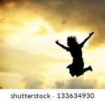 Boy jumping outdoor for joy happiness and freedom - stock photo
