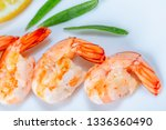 grilled prawns with rosemary.... | Shutterstock . vector #1336360490