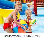 child on water slide at... | Shutterstock . vector #133636748