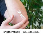 application of medical ointment ... | Shutterstock . vector #1336368833