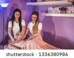 sports massage. two female... | Shutterstock . vector #1336380986
