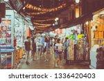 abstract blur crowds walk... | Shutterstock . vector #1336420403