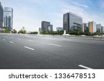 empty highway with cityscape of ... | Shutterstock . vector #1336478513