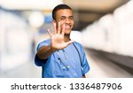 surgeon doctor man counting... | Shutterstock . vector #1336487906