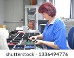 friendly woman working in a... | Shutterstock . vector #1336494776