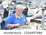 friendly woman working in a... | Shutterstock . vector #1336497686