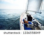 white yacht sails on a clear... | Shutterstock . vector #1336558049