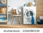 interior of a real laundry room ... | Shutterstock . vector #1336580150