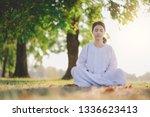young asian woman relaxes... | Shutterstock . vector #1336623413