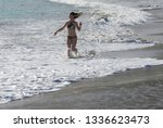 young girl running in the surf... | Shutterstock . vector #1336623473