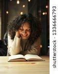 pretty girl reading a book in a ... | Shutterstock . vector #1336666793