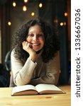 pretty girl reading a book in a ... | Shutterstock . vector #1336667036