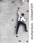 businessman climbs the wall as... | Shutterstock . vector #1336669259