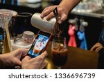 man taking a photo of barista... | Shutterstock . vector #1336696739