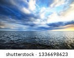 colorful sunset over the sea.... | Shutterstock . vector #1336698623