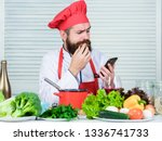man chef searching internet... | Shutterstock . vector #1336741733