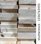 stack of new wooden studs  ... | Shutterstock . vector #1336763453