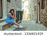 young smiling sitting on stairs ... | Shutterstock . vector #1336821929