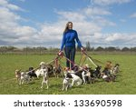 Stock photo portrait of a woman and a large group of chihuahuas 133690598