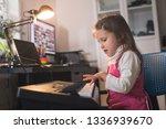 little girl child plays piano... | Shutterstock . vector #1336939670