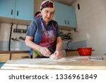 senior woman kneading the dough ... | Shutterstock . vector #1336961849
