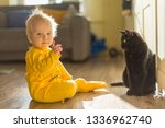 baby girl in a yellow jumpsuit... | Shutterstock . vector #1336962740