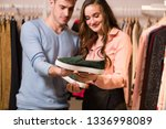 man and woman holds moccasins ... | Shutterstock . vector #1336998089
