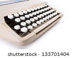 Side view of typewriter keyboard on white background - stock photo