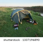 landscape with a tent with a... | Shutterstock . vector #1337196890