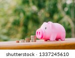 happy piggy bank and coins over ... | Shutterstock . vector #1337245610
