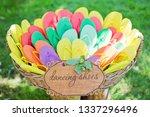 Basket With Colorful Flip Flops