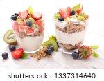 yogurt with muesli and fruits | Shutterstock . vector #1337314640
