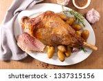 grilled lamb leg and potatoes | Shutterstock . vector #1337315156