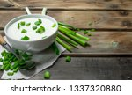 fresh sour cream in bowl with...
