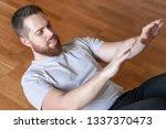 man pumping abs at home....   Shutterstock . vector #1337370473