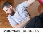 man pumping abs at home....   Shutterstock . vector #1337370479