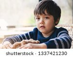 portrait of child sitting alone ... | Shutterstock . vector #1337421230