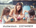 happy family mom daughter save... | Shutterstock . vector #1337449859