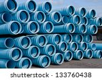 Stacks of C900 DR18 PVC water Pipe - stock photo